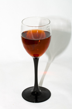 Wine glass with red wine on a white background