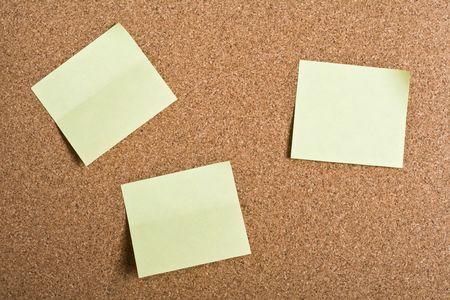 Yellow stickers on cork board Stock Photo - 6510059
