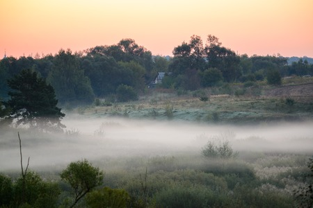 Foggy sunrise on the banks of a small river in Polesie Stock Photo