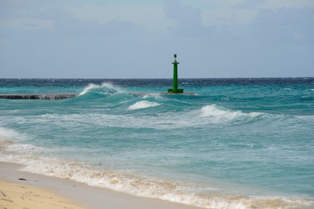 Stormy waves on the lighthouse and pier with interesting autumnal light. Cuba