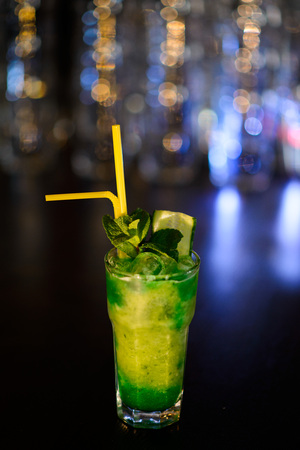 refreshing cocktail with lime, lemon and mint on the background of Boke