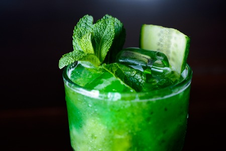 alcochol: refreshing cocktail with lime, lemon and mint