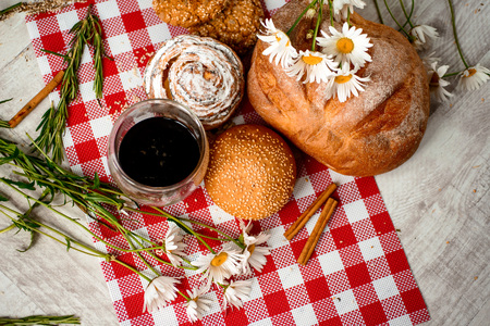 Coffee Cup, cracker, cookie, biscuit, chamomile flowers on a wooden table. Stock Photo