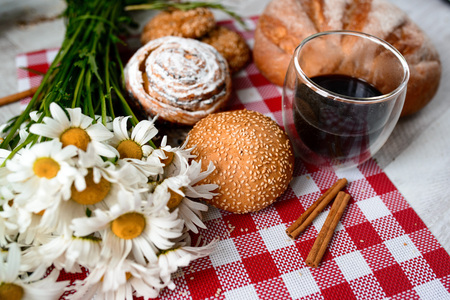 vibe: Coffee Cup, cracker, cookie, biscuit, chamomile flowers on a wooden table. Stock Photo