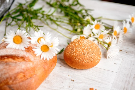 vibe: cracker, cookie, biscuit, chamomile flowers on a wooden table. Stock Photo