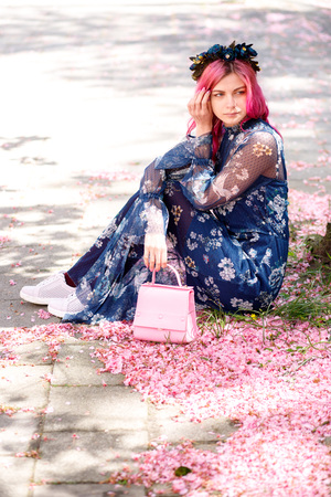young beautiful girl with pink hair standing near a tree with flowers, pink flowers, spring, sun, happiness, tenderness