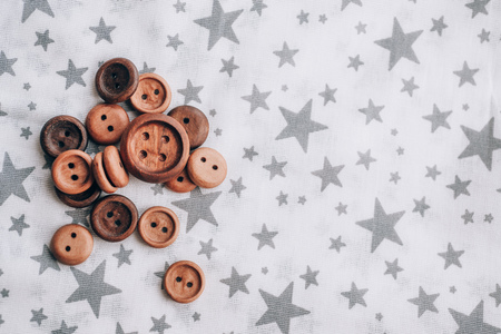 handmade wooden buttons on beautiful cotton fabric in grey stars
