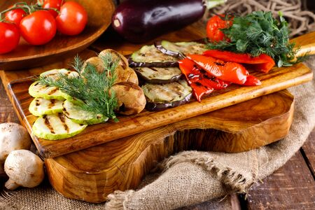 Fried healthy vegetables on a cutting Board on a wooden table background 版權商用圖片