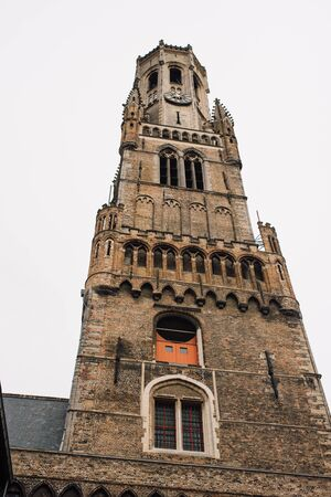 View of Belfort tower from the market square. Bruges, Brussels, on a cloudy day