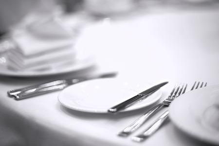 plates napkins forks knives on a white tablecloth Reklamní fotografie