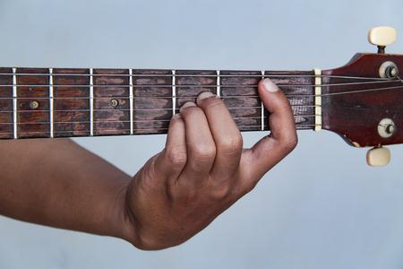 playing guitar, in chord B flat major Stockfoto