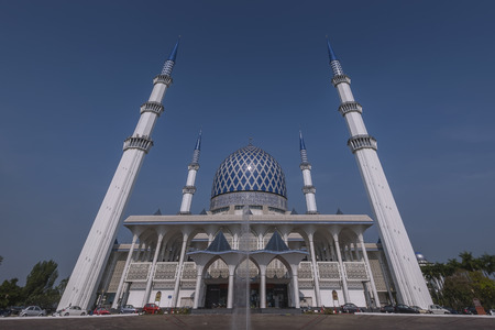 alam: View of  Sultan Salahuddin Abdul Aziz Shah  known as the Blue Mosque during evening. It is located in Shah Alam and is Malaysias largest mosque.