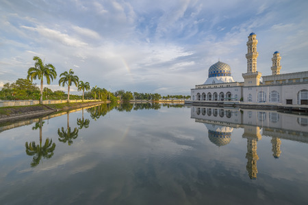 likas: Tree  mosque with reflection during evening Stock Photo