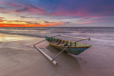 Lonely boat during sunset 写真素材