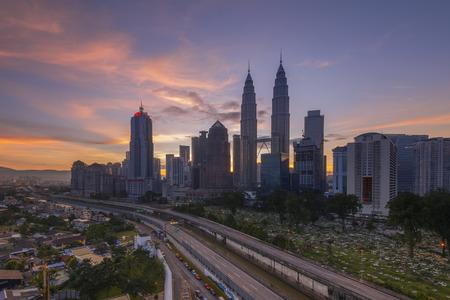 klcc: KUALA LUMPUR, MALAYSIA - DEC 12, 2015; Sunrise in the city center and klcc kuala lumpur Malaysia