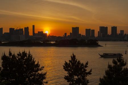 Sunset view of Tokyo Skyline and Rainbow Bridge