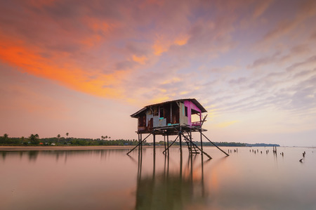 Abandoned floating house during a beautiful sunset 写真素材