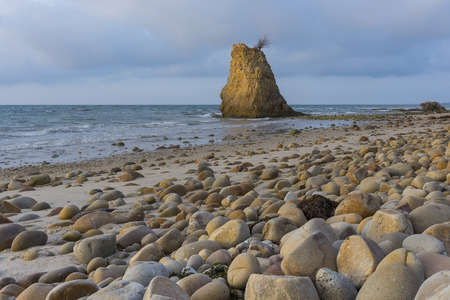 Stone and beach during a sunset at Borneo Sabah, Malaysia Asean