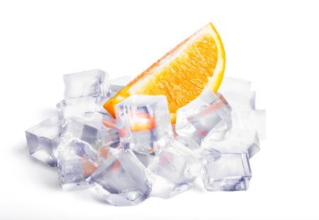 Ice cubes and orange isolated on white background