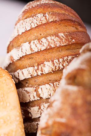 Long loaf and other bakery close up photo