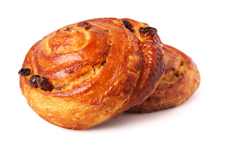 chelsea: Freshly baked delicious sweet bun with raisins isolated white background