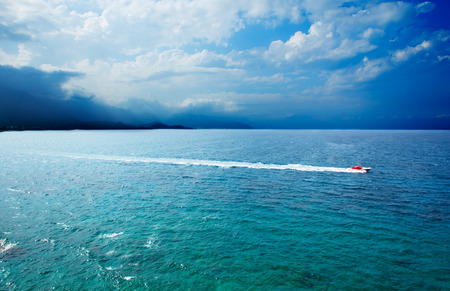 speedboat: Beautiful seascape with speedboat and mountains