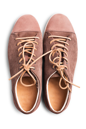 Brown suede sneakers isolated on white background photo