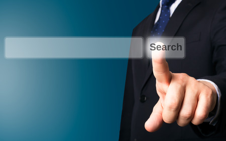 screen search: Business person working with modern virtual technology (screen search button)