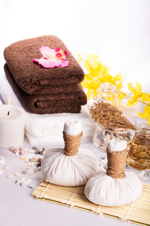 SPA still life: massage oil, towels,pebbles and herbs