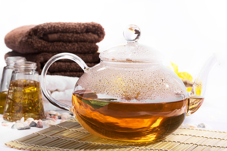 SPA still life: aromatic oil, towels: tea, teapot, photo
