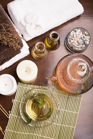 SPA still life: green tea, aromatic oil, towels photo