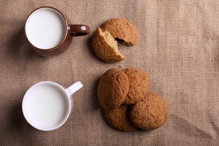 sacking: Oatmeal cookies and milk on the sacking Stock Photo
