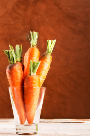 Fresh carrot in tbe glass (copy space)
