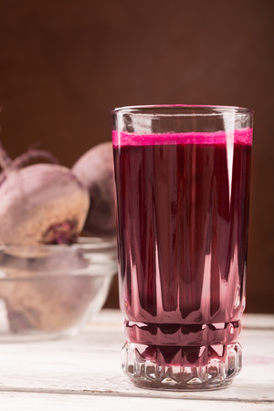 beet juice: Glass of beet juice on the white table