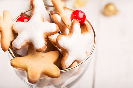 christamas: Glass of Christmas cookies on the white table