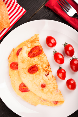 aon: Omelette with tomatoes aon the white plate Stock Photo