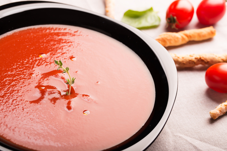 gazpacho: Spanish tomato gazpacho soup decorated with thyme