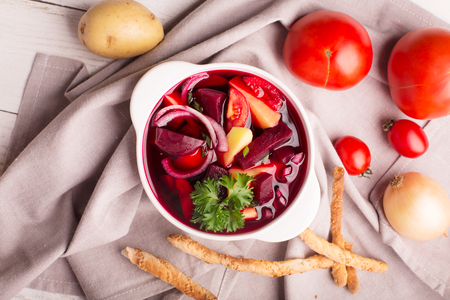 red cooked: Russian traditional borsch soup with beets and vegetables Stock Photo