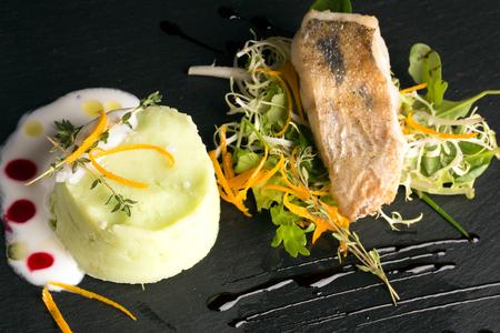 zander: Mashed cauliflower and potatoes with zander on the green salad Stock Photo