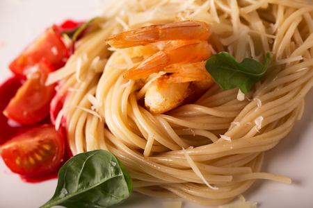 parmezan: Spaghetti with shrips and parmezan on the white plate