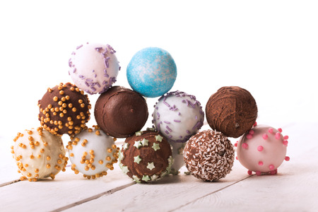 sweet food: Batch of colorful cake pops isolated on white background