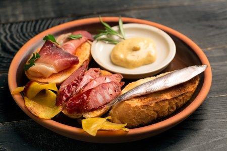 crusty: Tasty tapas with fish and meat on crusty bread