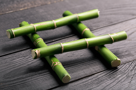 cutted: Photo of cutted Bamboo stem on a wooden table Stock Photo