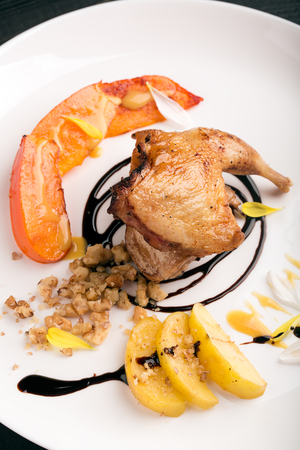 caramelized: Quail thigh with caramelized apples and persimmons