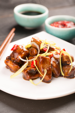 pao: Traditional chinese kung pao fried chicken with vegetables and sauce