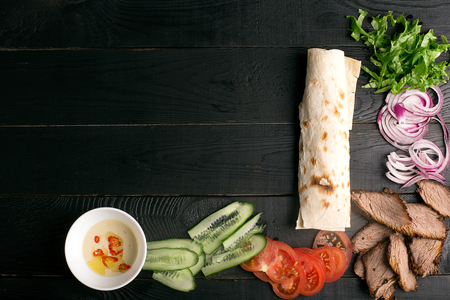 Traditional meat doner kebab with vegetables. Background with copy space