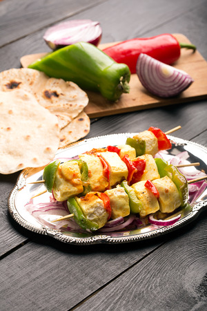 cubed: Indian paneer curd cheese fried with vegetables Stock Photo