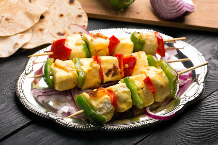 Indian paneer curd cheese fried with vegetables Stock Photo