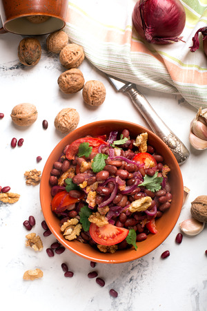 dinner menu: Red beans fried with onions, tomatoes and walnuts Stock Photo