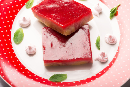 crumbly: Crumbly cake with jam (jelly) prepared from cranberry and strawberry